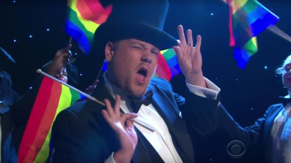 James Corden sings musical takedown of Trump's trans military ban