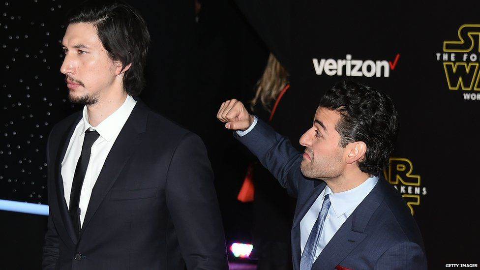 Adam Driver and Oscar Isaac at the LA premiere for Star Wars: The Force Awakens - Oscar pretends to punch Adam