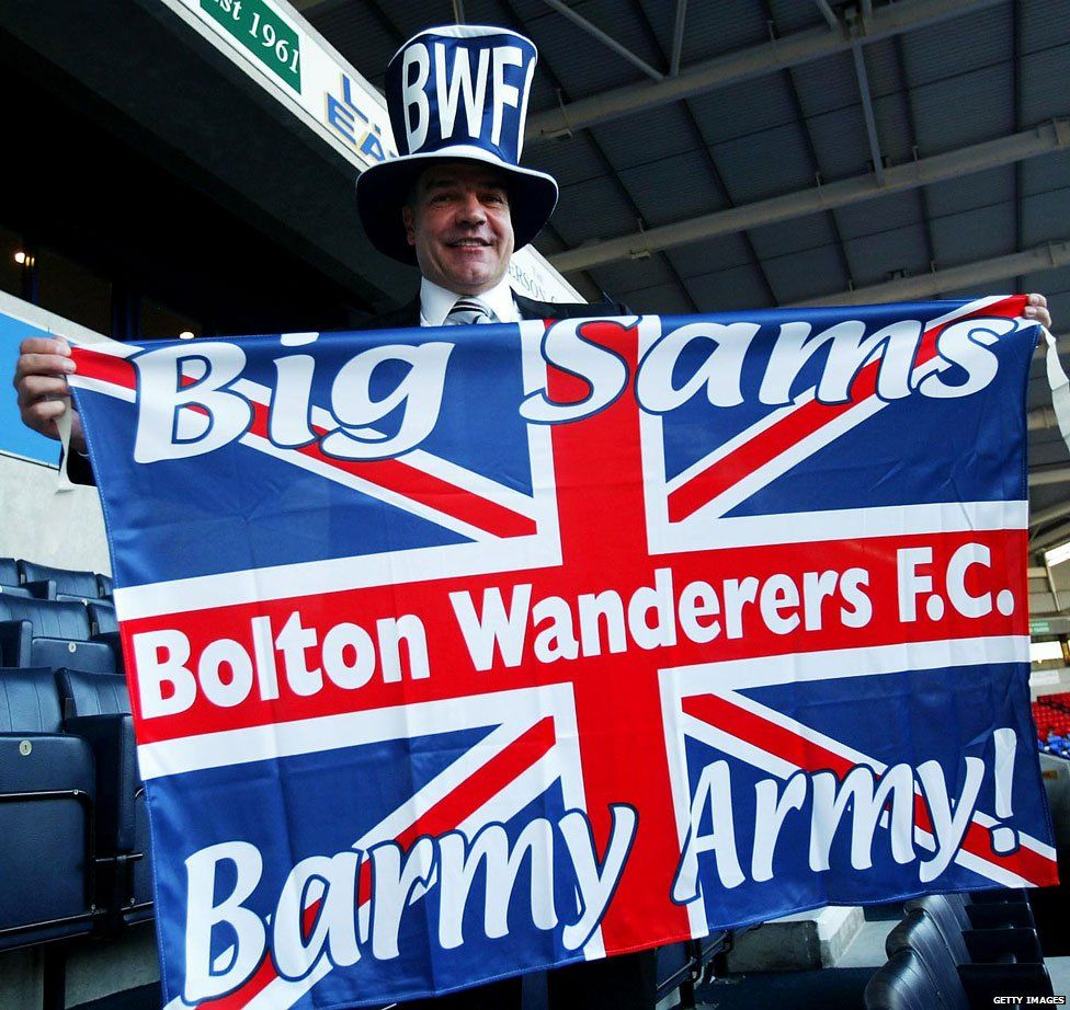 Sam celebrating with a Bolton flag