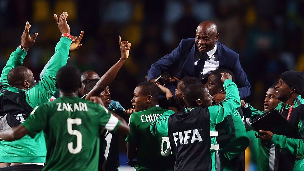 Nigeria players and team members carry head coach Emmanuel Amuneke after winning the U-17 World Cup