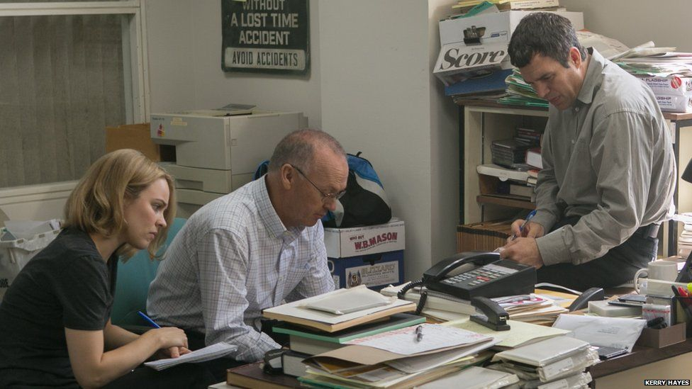 Rachel McAdams, Michael Keaton and Mark Ruffalo in the Boston Globe Spotlight office in a scene from the film