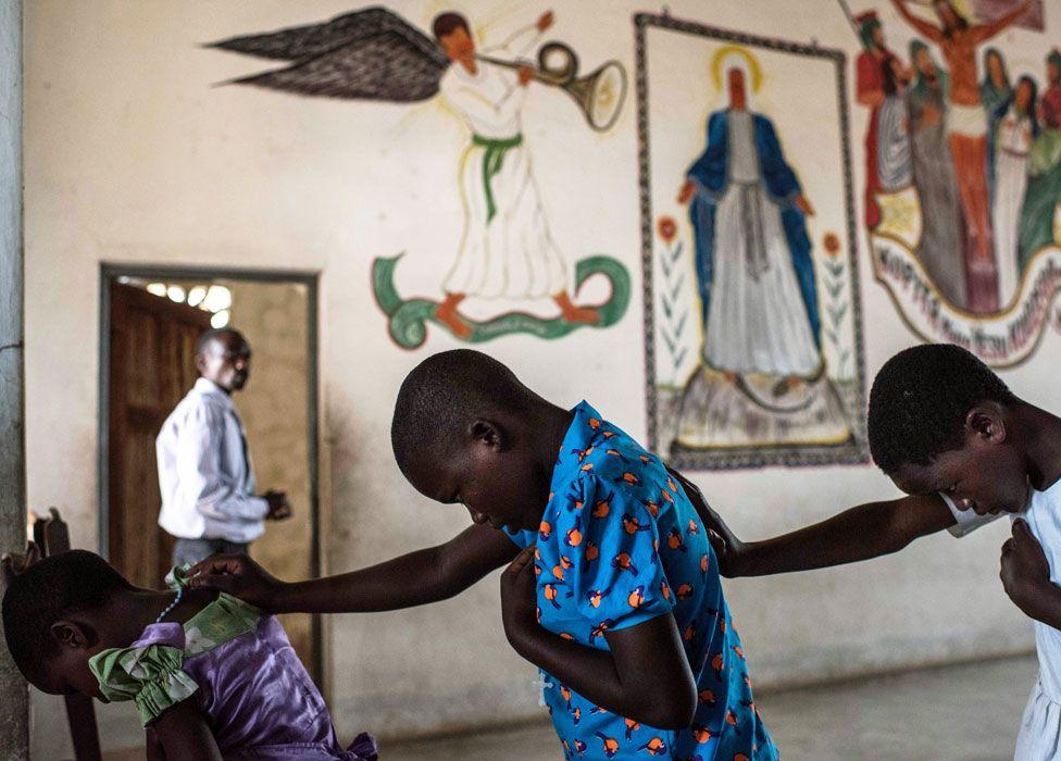 Girls praying at Mofolo Woyera church in Mulele village, Ghana - Sunday 11 September 2016