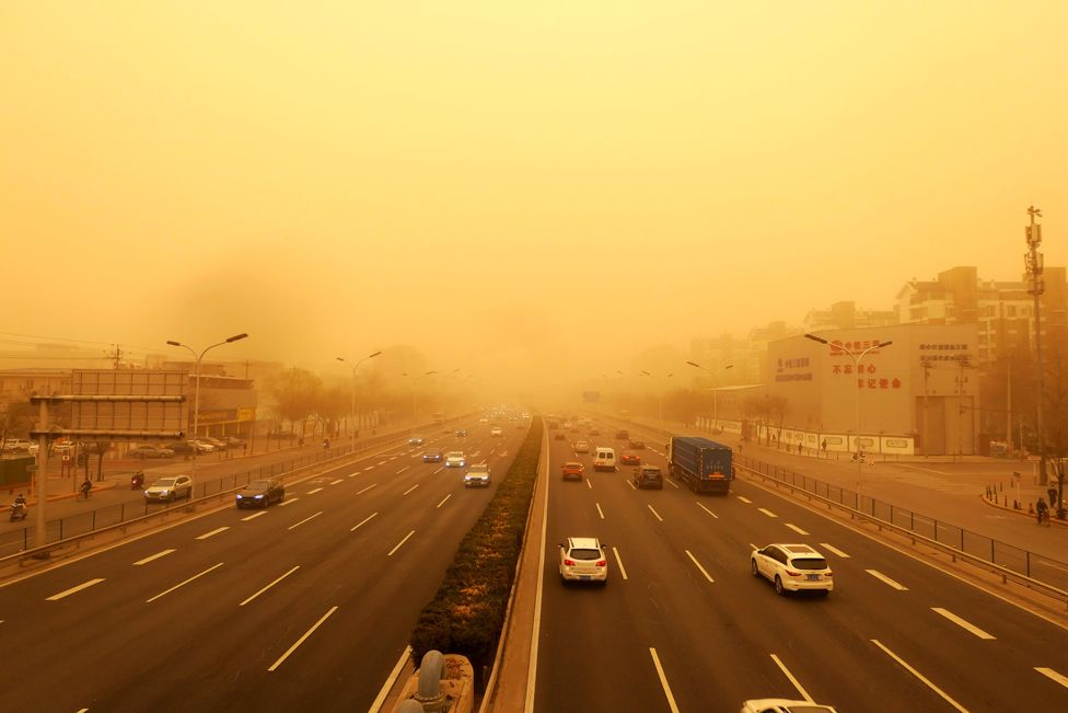 Traffic during a sandstorm in Beijing, on 15 March 2021
