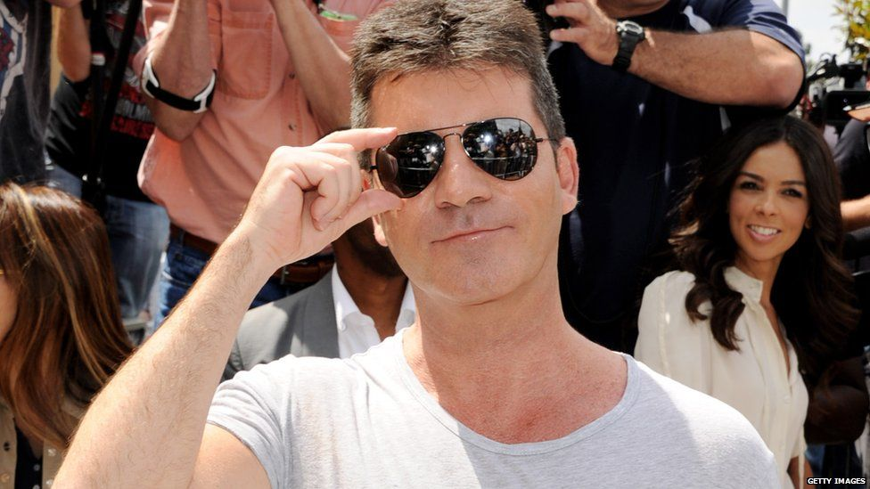 Simon's back on The X Factor's judging panel