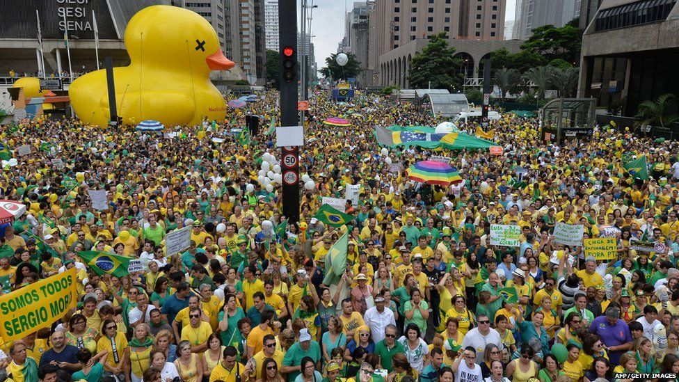 Demonstrators take part in a protest against President Dilma Rousseff and the ruling Workers Party in Paulista Avenue, in Sao Paulo, on March 13, 2016.