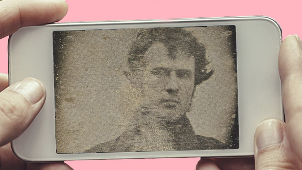 A phone showing Robert Cornelius's selfie