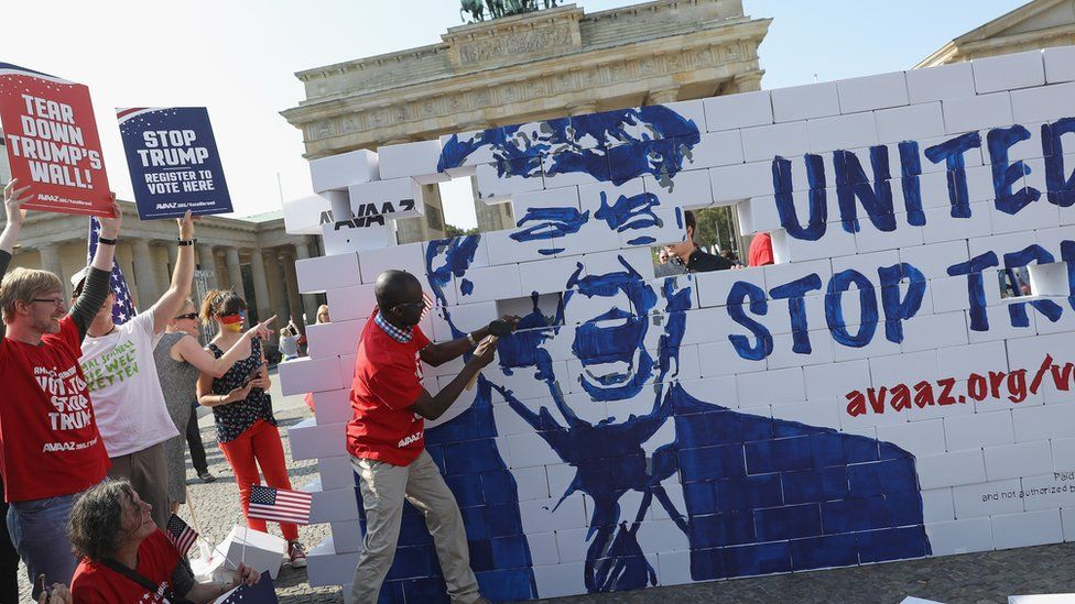 Protestors building a Trump wall