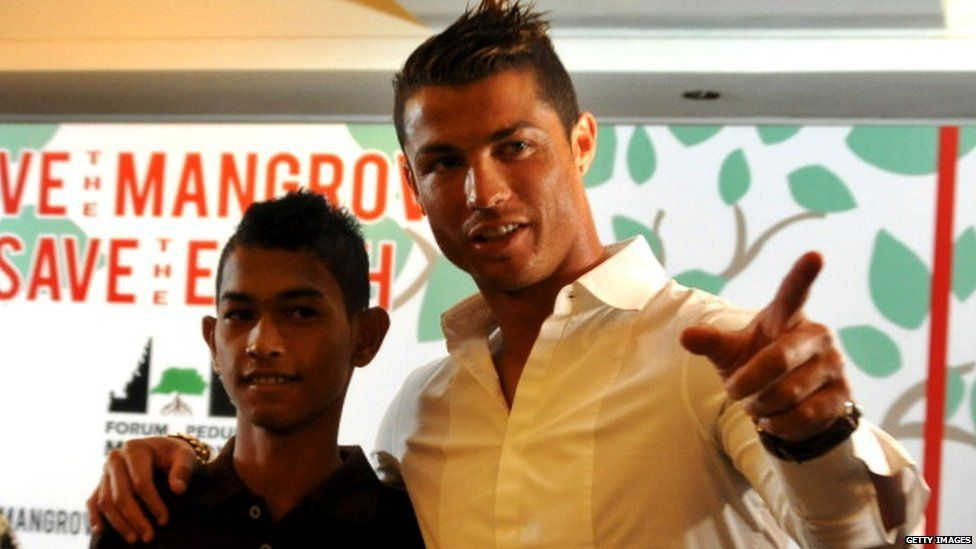 Cristiano Ronaldo is reunited with Martunis in 2013 after giving his family financial assistance.