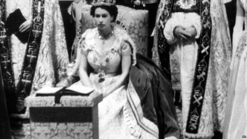 The Queen sits during her coronation in 1953