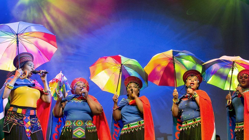 Singers holding umbrellas performing during the 2016 eThekwini Living Legends Awards ceremony in Durban, South Africa - Saturday 3 September 2016