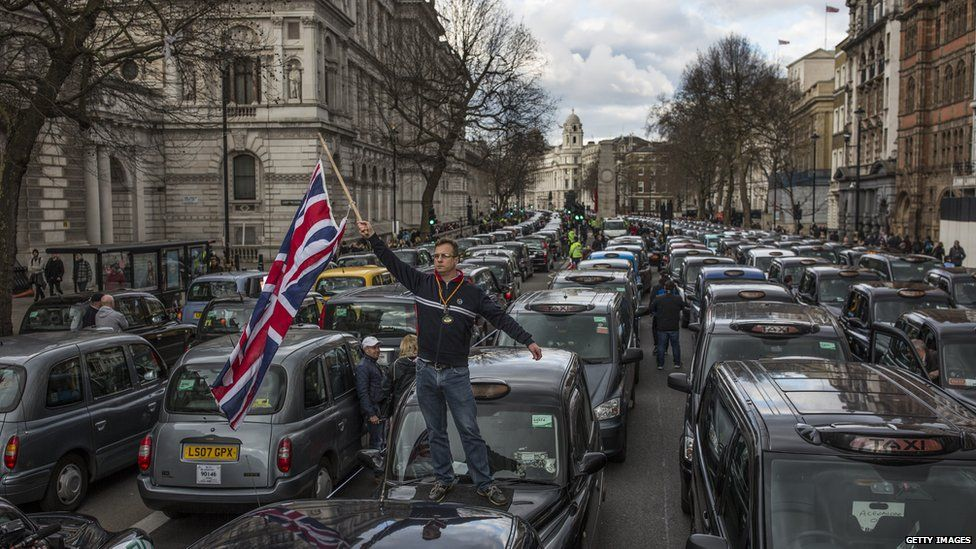 Uber drivers stage a protest in central London