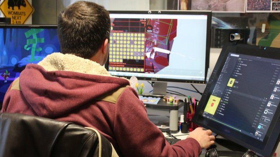 games designer at desk