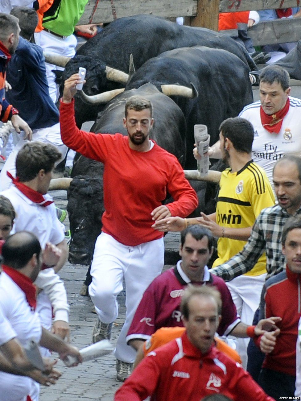 People at the running of the bulls in Pamplona, Spain, in 2014