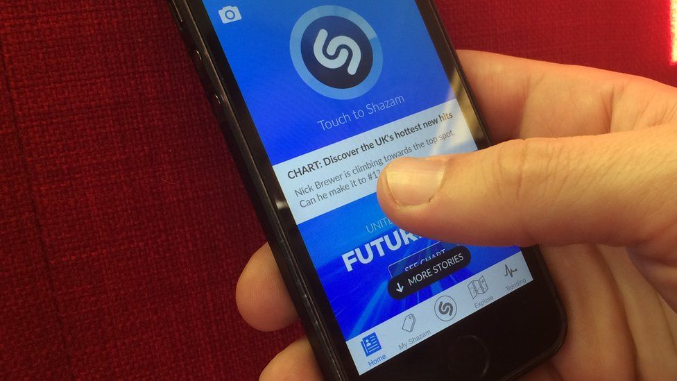 Someone accessing Shazam through a mobile app