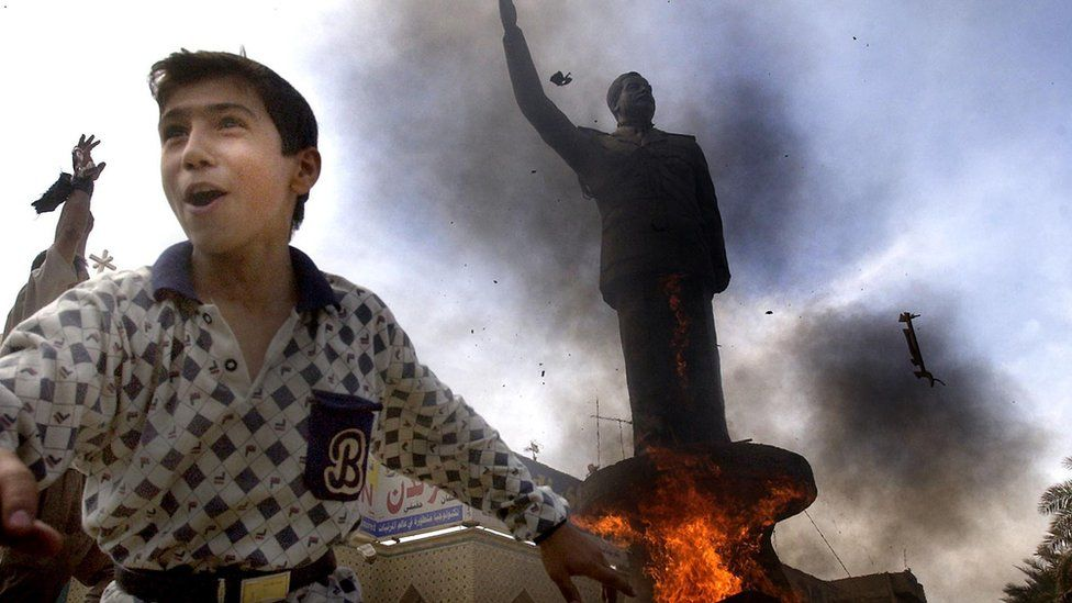 The statue of ousted Iraqi President Saddam Hussein is set on fire on April 12th 2003 in downtown Baghdad in Iraq.