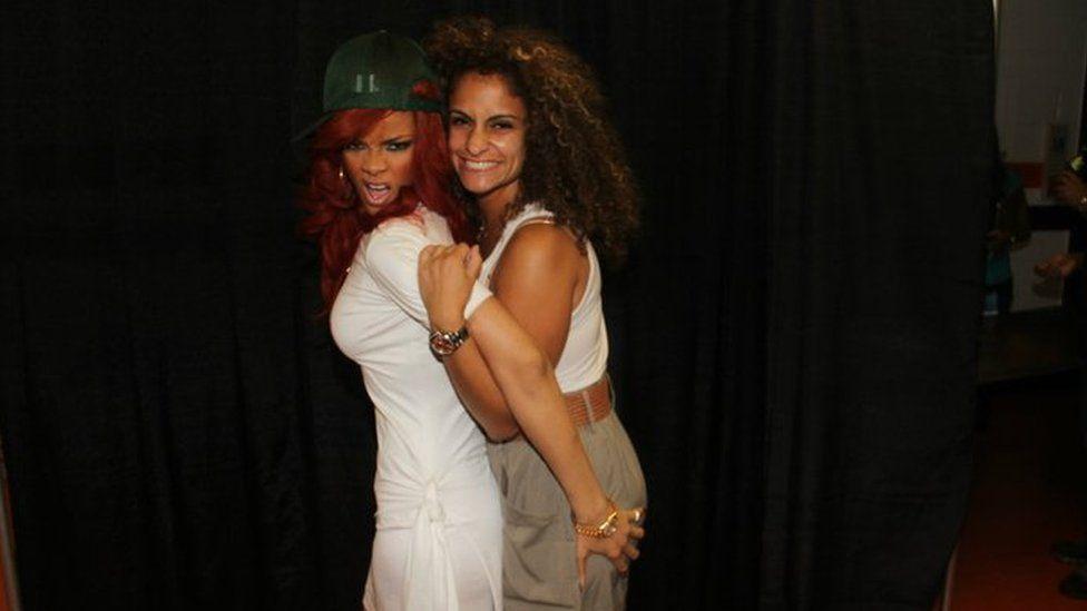 Rihanna meeting a fan on her Loud tour in 2011