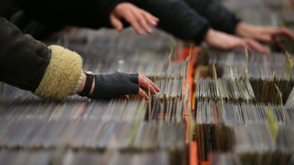 man hand with records