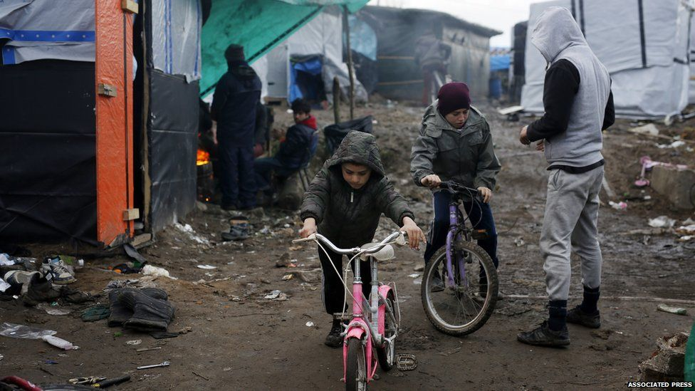 Children cycling in the Calais camp