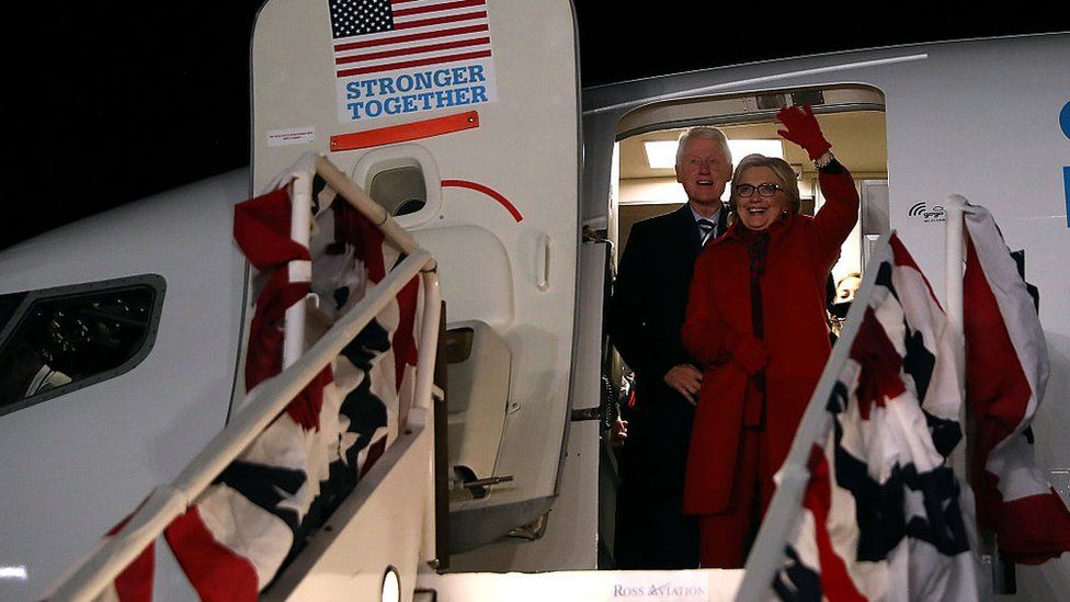 Hillary and Bill touch down