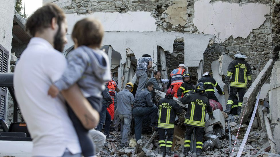 Firefighters search amid rubble following an earthquake in Accumoli, central Italy - 24 August 2016