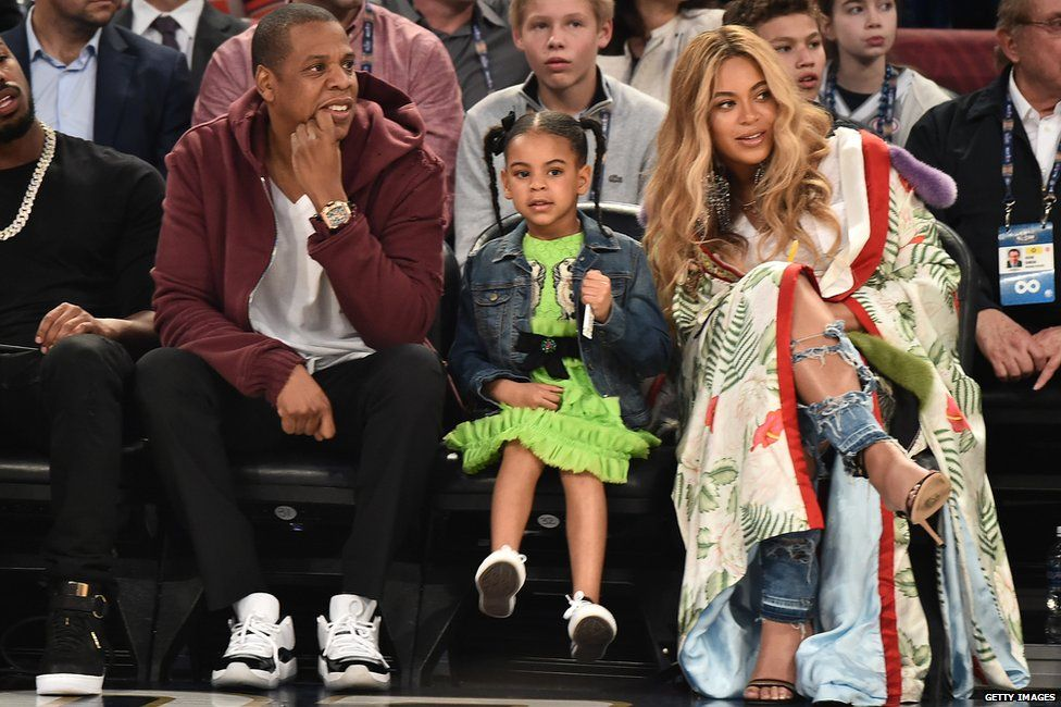 The rapper and his wife Beyonce with their daughter Blue Ivy at a basketball game