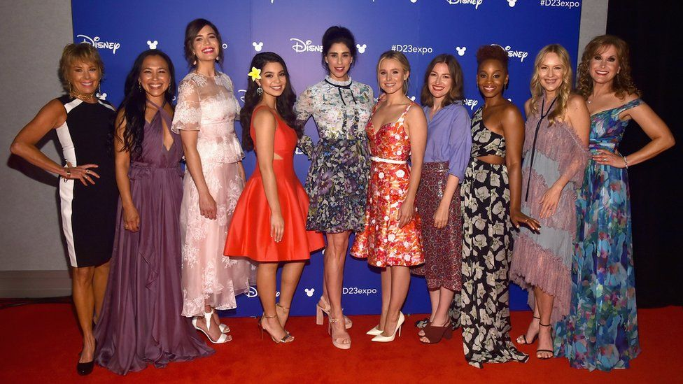 Paige O'Hara (Beauty and the Beast), Irene Bedard (Pocahontas), Mandy Moore (Rapunzel), Auli'i Cravalho (Moana), Sarah Silverman (Wreck It Ralph), Kristen Bell (Frozen), Kelly Macdonald (Brave), Anika Noni Rose (The Princess And The Frod), Linda Larkin (Aladdin), and Jodi Benson (The Little Mermaid)