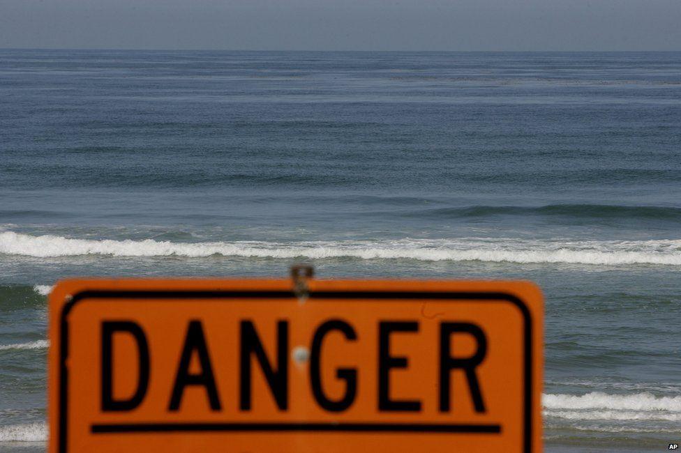 Danger sign on a beach in California