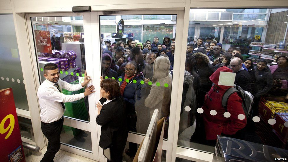 People queuing outside a supermarket