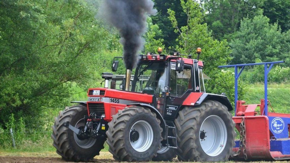 A tractor with a modified exhaust