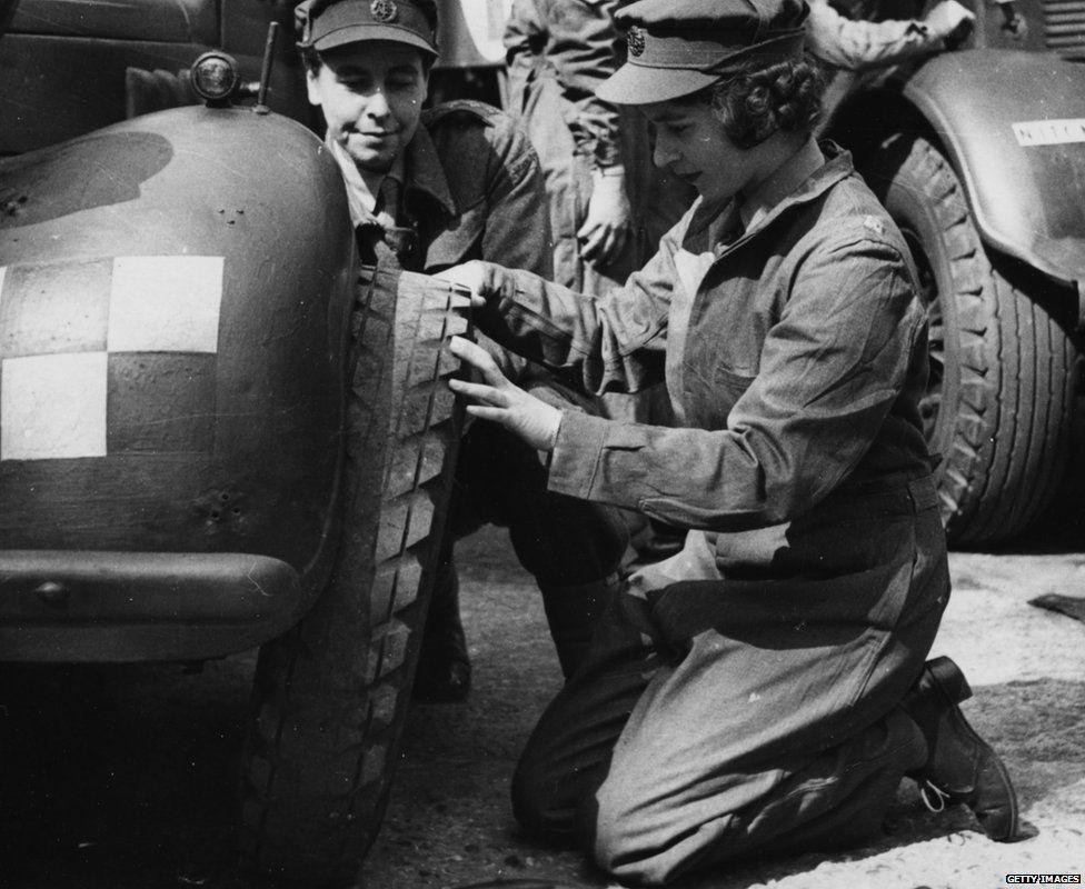 Queen Elizabeth II changing a tyre in World War 2