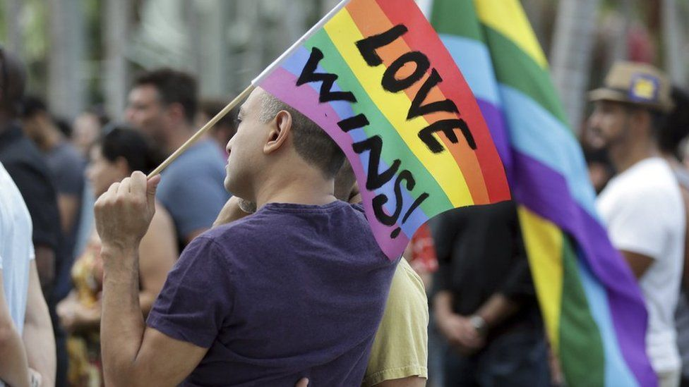 Mourners at a vigil in Florida for the victims of the Orlando mass shooting