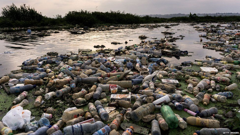 plastic bottles polluting a river