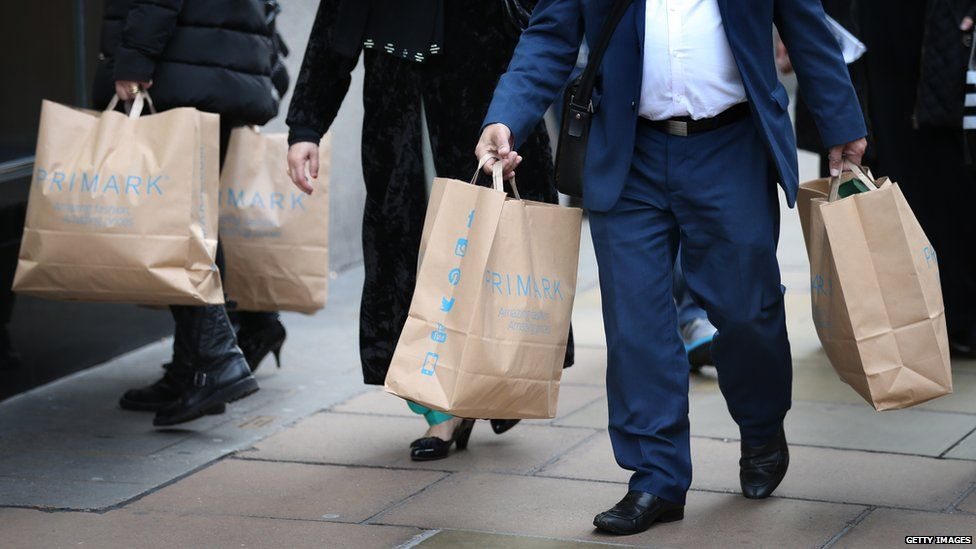 People carrying Primark shopping bags