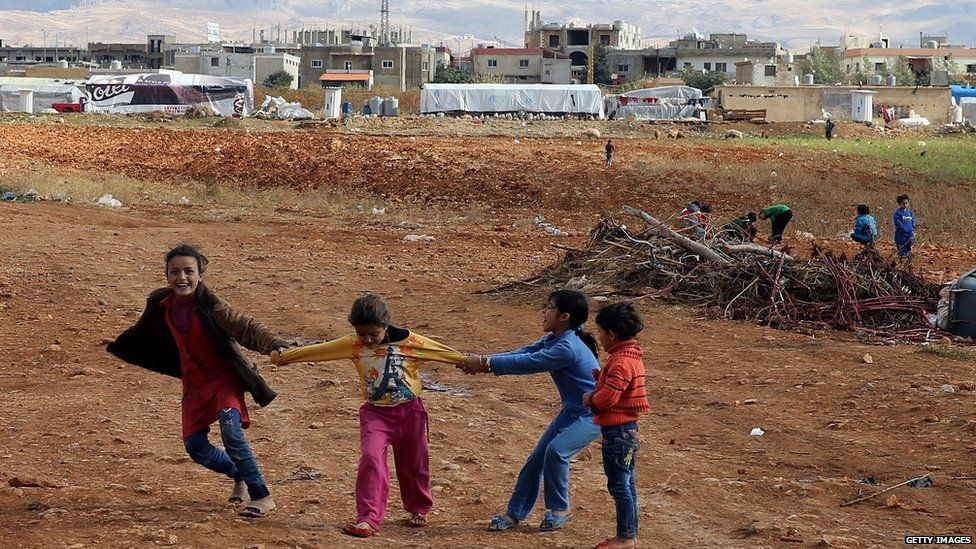 Syrian refugee children play at a makeshift camp by Taybeh village, in Lebanon's eastern Bekaa Valley
