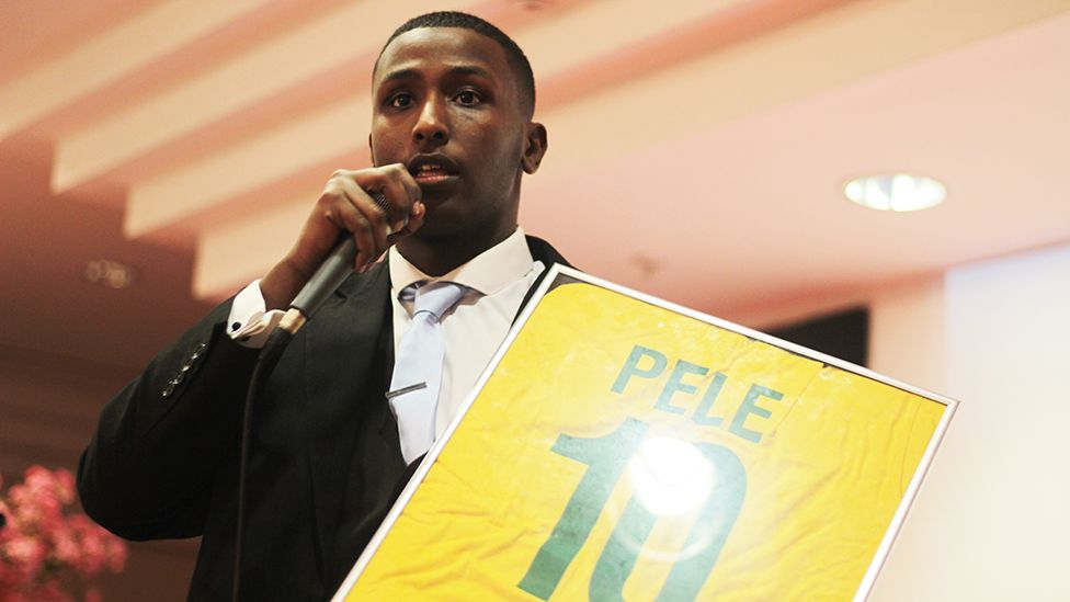 AbdulKadir auctioning a signed Pele shirt