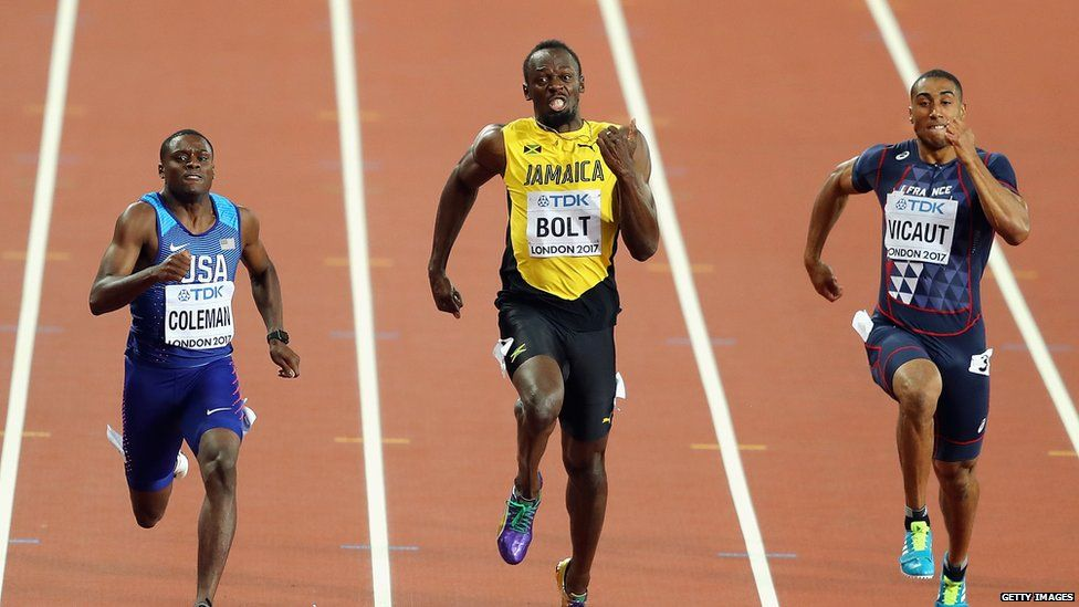 This is a photo of Christian Coleman and Usain Bolt racing side by side in the 100m finals.