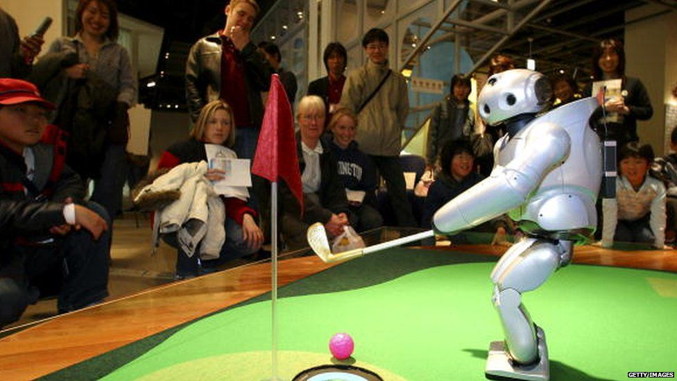 Sony's walking robot, Qrio plays golf in 2004