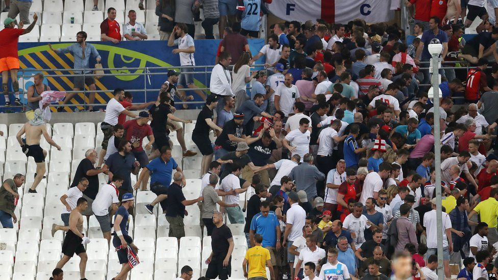 Fans fighting in the stands
