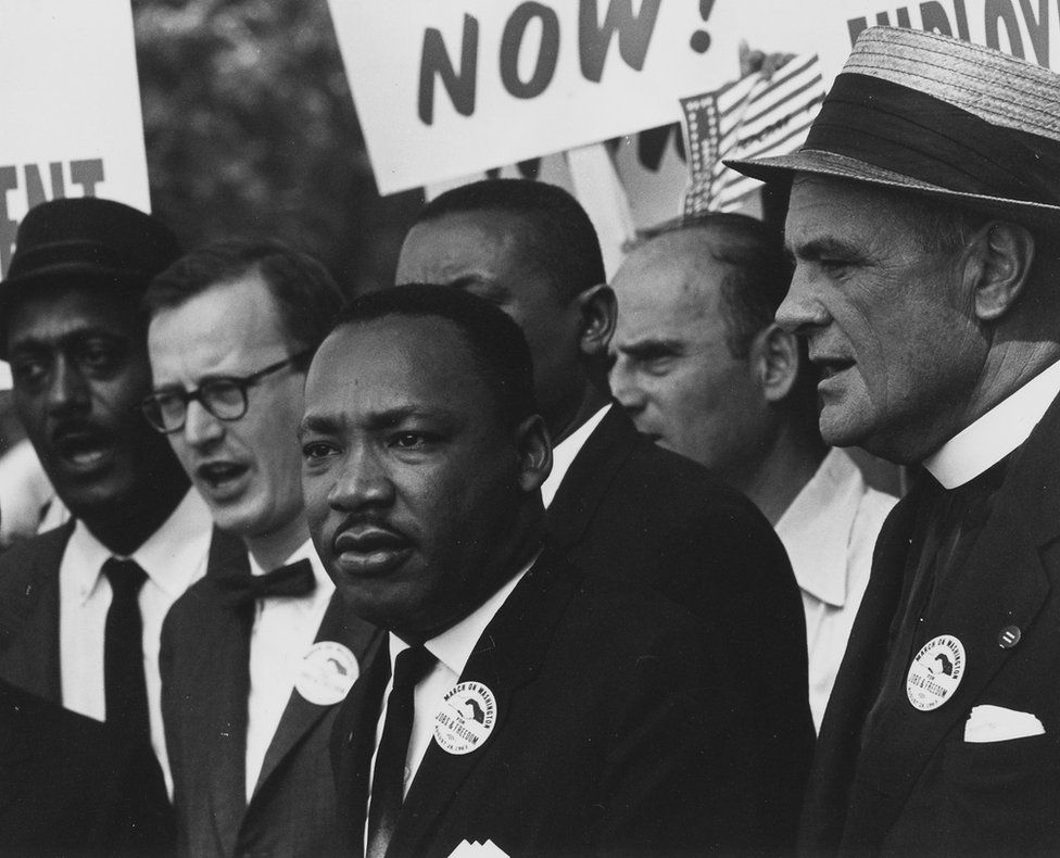 Dr. Martin Luther King stands with others at a march