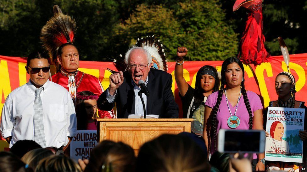 This is a photo of senator Bernie Sanders at a protest in Nortn Dakota.