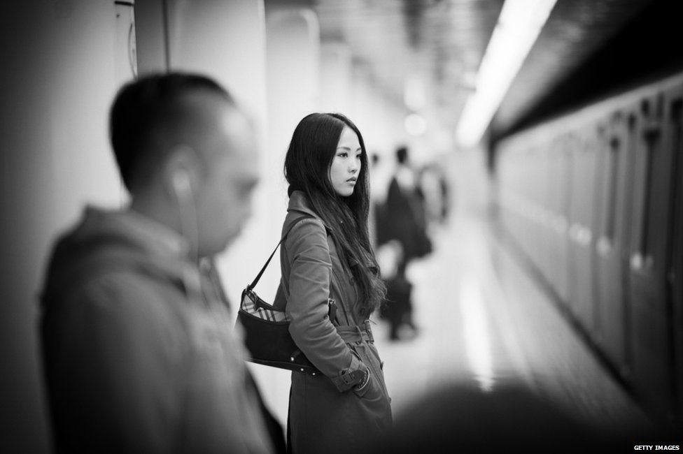 Woman getting on to a train in Tokyo