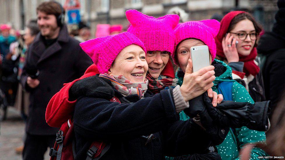 Women wearing pussy hats