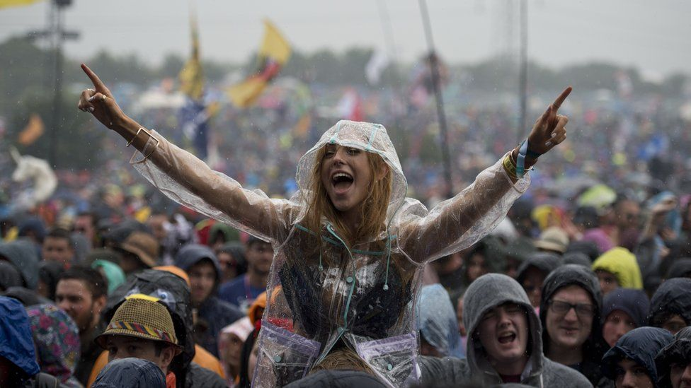 Woman in the crowd at Glastonbury