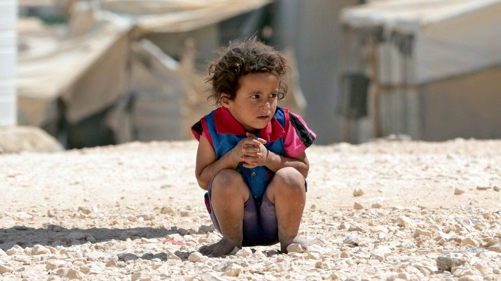 A young Syrian refugee looks on at the UN-run Zaatari camp, north east of the Jordanian capital Amman