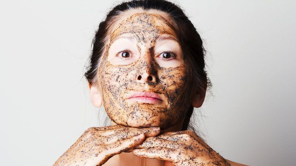 woman with face scrub on