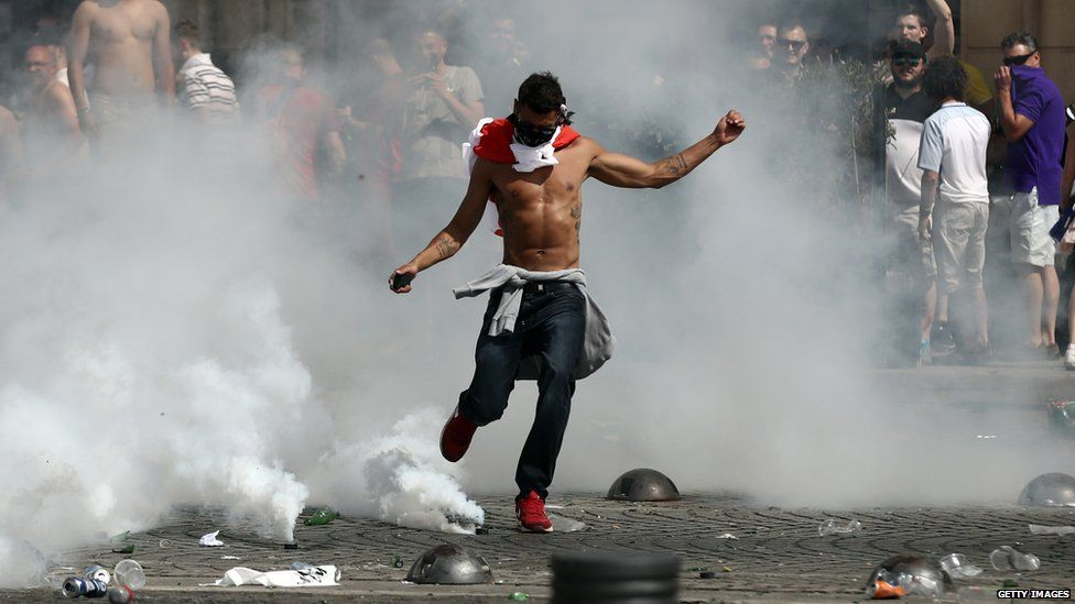 England fan kicking a gas canister