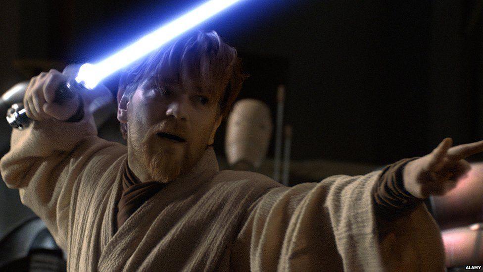 Obi Wan Kenobi with a lightsaber
