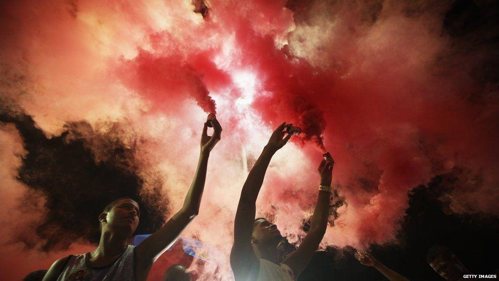 Anti-impeachment protestors spray red smoke after former President Luiz Inacio Lula da Silva, 'Lula', spoke at a rally supporting President Dilma Rousseff in the historic Lapa neighbourhood on April 11, 2016 in Rio de Janeiro, Brazil.