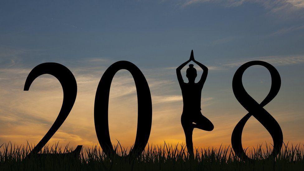 Woman doing yoga in 2018 pose