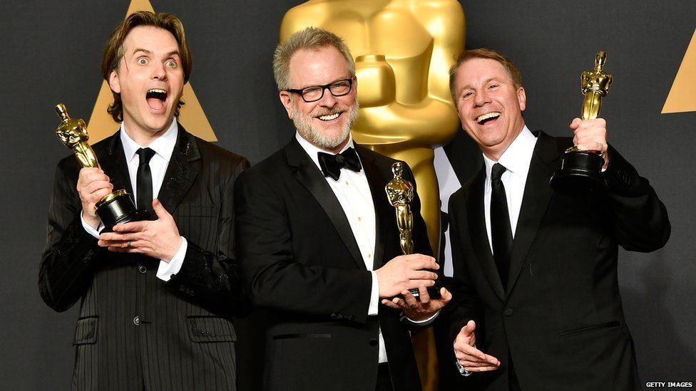Co-directors Byron Howard and Rich Moore and producer Clark Spencer,